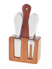 Set of stainless steel cheese cutlery, with white handles and wooden block, isolated on white background