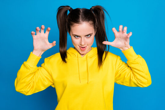 Close-up portrait of her she nice attractive pretty childish evil mad creepy girl pretending attack zombie cruel maniac fooling isolated over bright vivid shine vibrant blue color background
