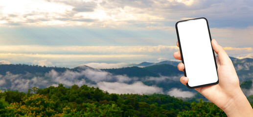 beautiful female hand holding smart phone with black screen against nature moutain with clound background, technology and nature concept. banner and copy space