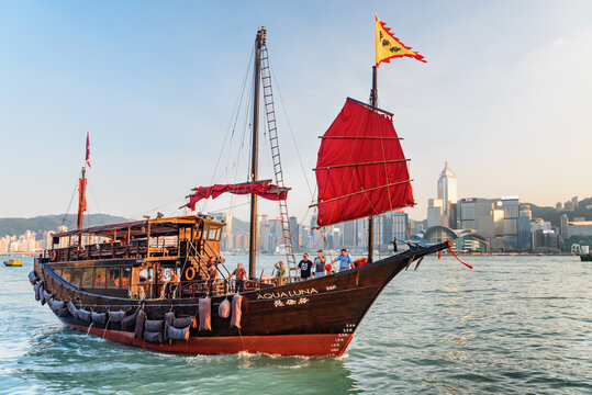 Chinese sailing ship with red sails in Victoria harbor