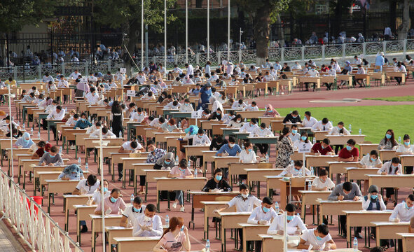 School graduates take university entrance exams at a sports arena amid the outbreak of the coronavirus disease in Tashkent