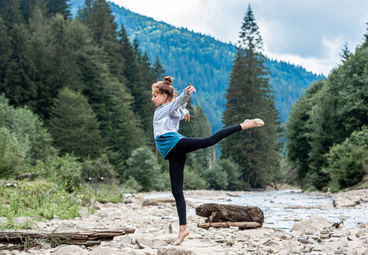 Young girl performing gymnastics in nature