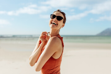 Tourist woman standing on beach