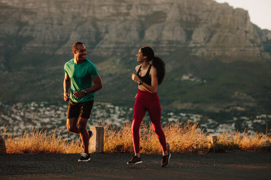 Athletic couple on a long distance run