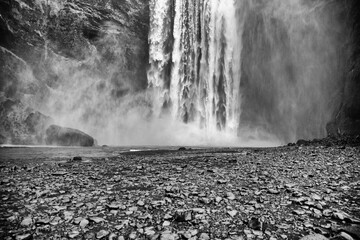 Skogarfoss, a waterfall on the southern ring road, Iceland. Black and white image Fotomurales