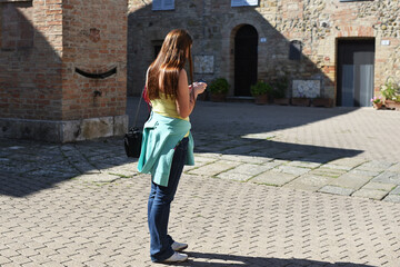Girl with mobile phone, Tuscan, Italy
