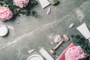 Printed roller blinds India Facial roller, gua sha massager, oil bottle, towel, pink peonies on marble background. Copy space. Flat lay. Top view. Routine facial skin care, body treatment, spa concept.