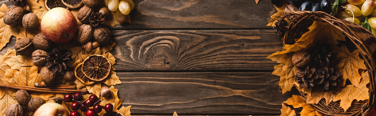 top view of autumnal harvest and decoration on brown wooden background, panoramic shot