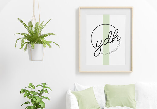 Frame Mockup in Living Room with Green Plants and Sofa