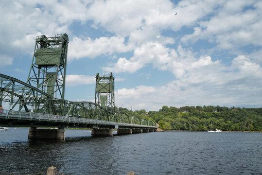 Historic iron lift bridge over water