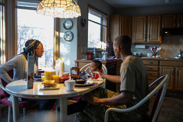 Military family eating at breakfast table