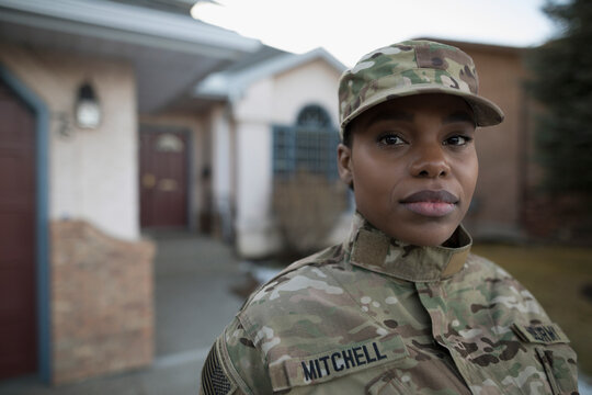Portrait of army soldier standing in driveway