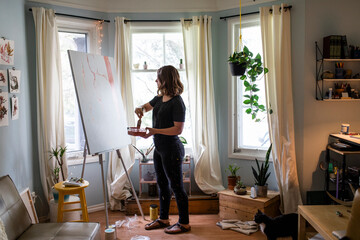 Artist starting work on large painting