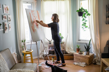 Artist working on large painting