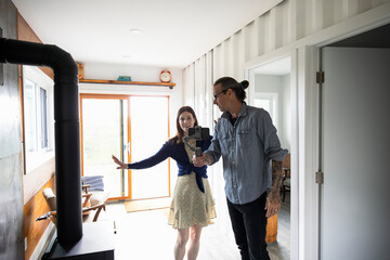 Couple filming at home in small rustic kitchen