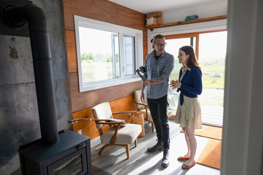 Couple filming vlog in small home