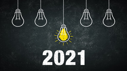 Numbers 2021 on a rustic background with 5 light bulbs.