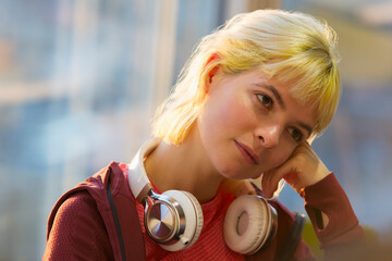 Thoughtful young woman with headphones