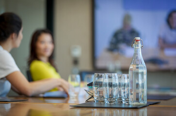 Water bottle and glasses on conference room table