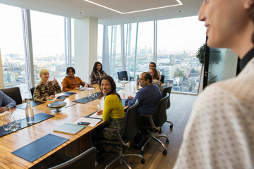 Business people in highrise conference room meeting