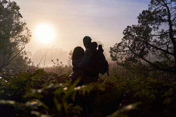 Silhouette serene young couple enjoying sunset in nature