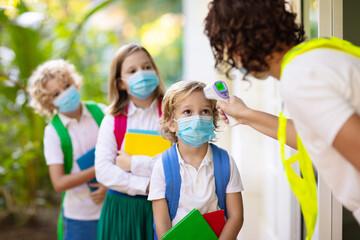 Wall Murals Equestrian Temperature check at school. Child in mask.