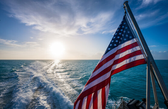 American Flag and Sunrise Over Gulf of Mexico