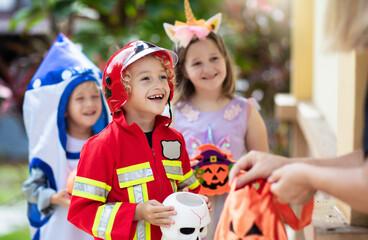 Kids trick or treat. Halloween fun for children.