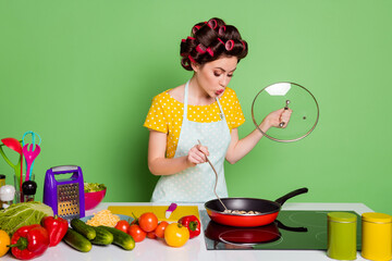 Portrait of her she nice attractive pretty glamorous cheery funny wife preparing romantic healthy useful meal dinner frying mushroom pout lips isolated over green color background