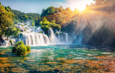 Captivating morning scene of Krka National Park, Lozovac village location, Croatia, Europe. Amazing  sunrise on Skradinski Buk waterfall. Beautiful world of Mediterranean countries.