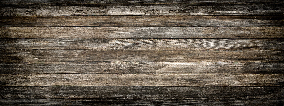 panoramic grey grunge background of old wooden boards with vignette