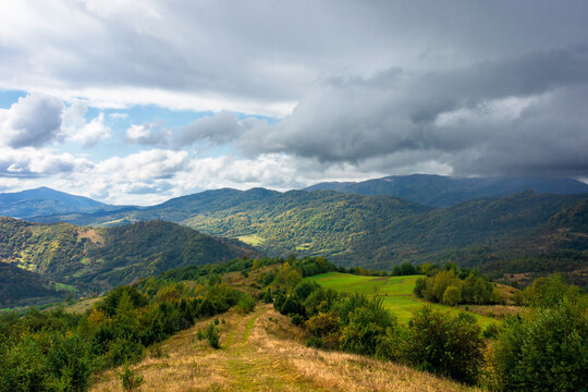 autumnal countryside on a cloudy day. beautiful mountain scenery of carpathians. abandoned rural area