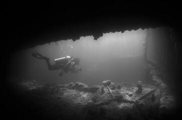 underwater scuba diver ship wreck caribbean sea