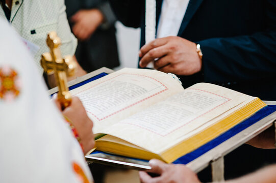 Christians and priest are congregants join hands to pray and seek the blessings of God, the Holy Bible. Sharing the gospel with copy space. Sunday readings, Bible.