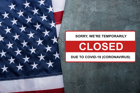 USA Flag of United States of America with sign closed due to Coronavirus Covid-19