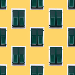 creative pattern green wooden window with shutters in white frame on yellow wall