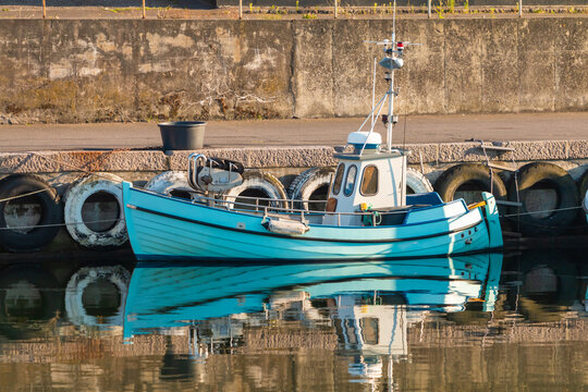 Small fishing boat docked in Bornholm Ronne port.