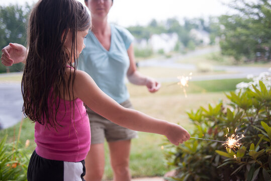 First Sparklers for Little Girl on July 4th