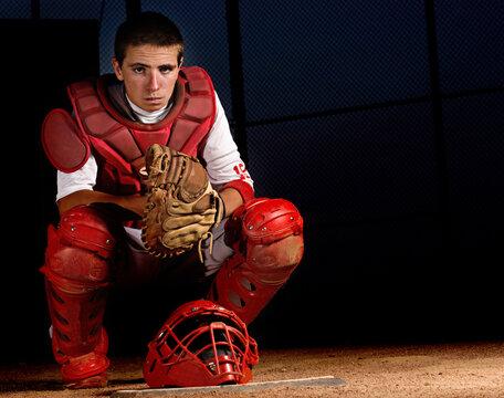 Baseball catcher behind homeplate.