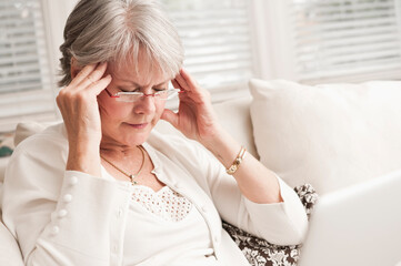 Mature Woman Rubbing Her Head With Terrible Headache