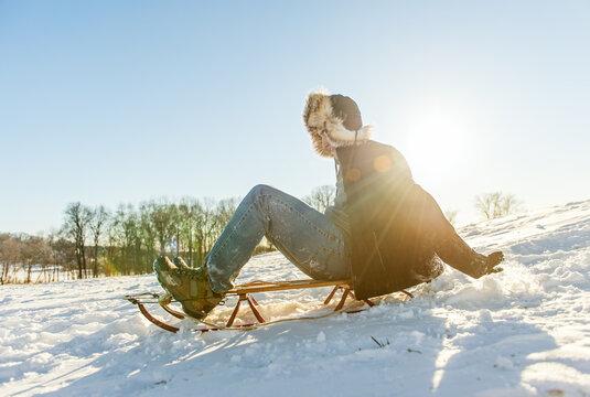 Man with runner sled on sledding hill