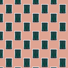 creative pattern green wooden window with shutters in white frame on pink wall