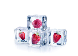Ice cubes with berries on white background