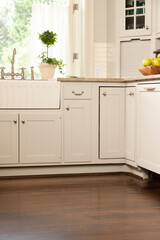 Low angle view of kitchen counter and hardwood floors