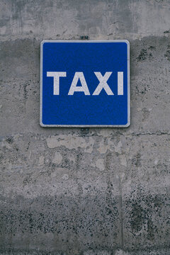 Blue Taxi Sign On a Concrete Grunge Wall