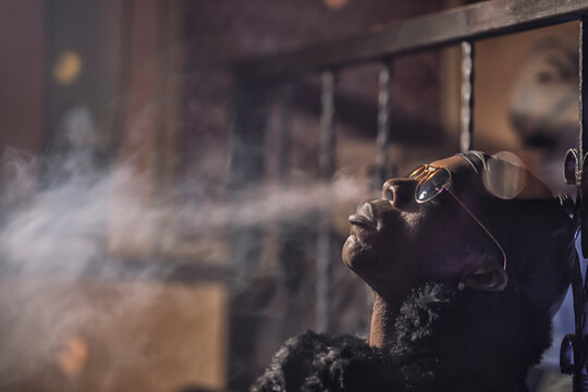 black man smokes hookah, smoke
