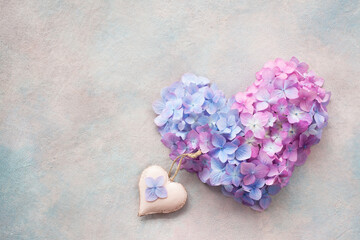 Floral heart of hydrangea on a decorative background, space for text.