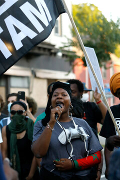 A woman speaks to the crowd as demonstrators take part in a protest in Rochester, New York