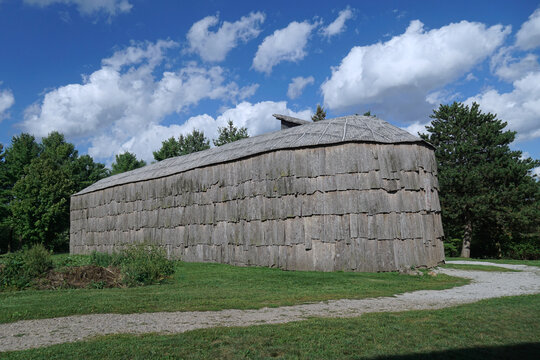 reproduction of an Iroquois longhouse made of tree bark in a location where an ancient village stood