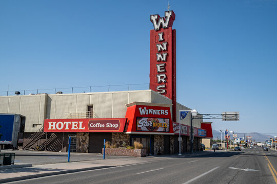 Winnemucca, Nevada - August 5, 2020: Exterior view of Winners Casino, and hotel with its classic retro neon sign in the downtown area